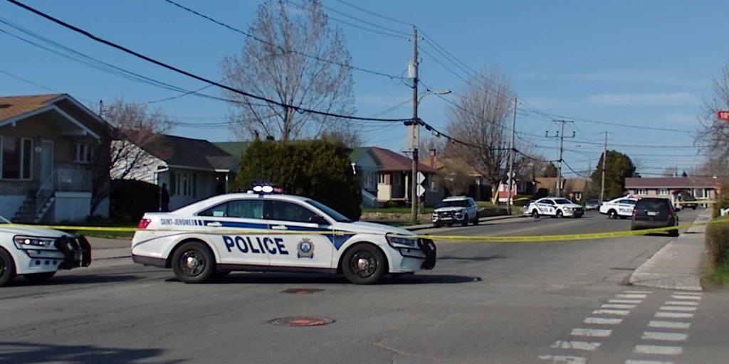 Plusieurs agents du Service de police de Saint-Jérôme avaient fermé l'accès à la 9e rue à Saint-Antoine, le 5 mai 2016.